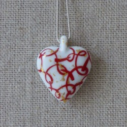 collier coeur ruban rouge et or