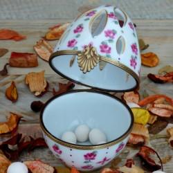 Pink and gold porcelain egg...
